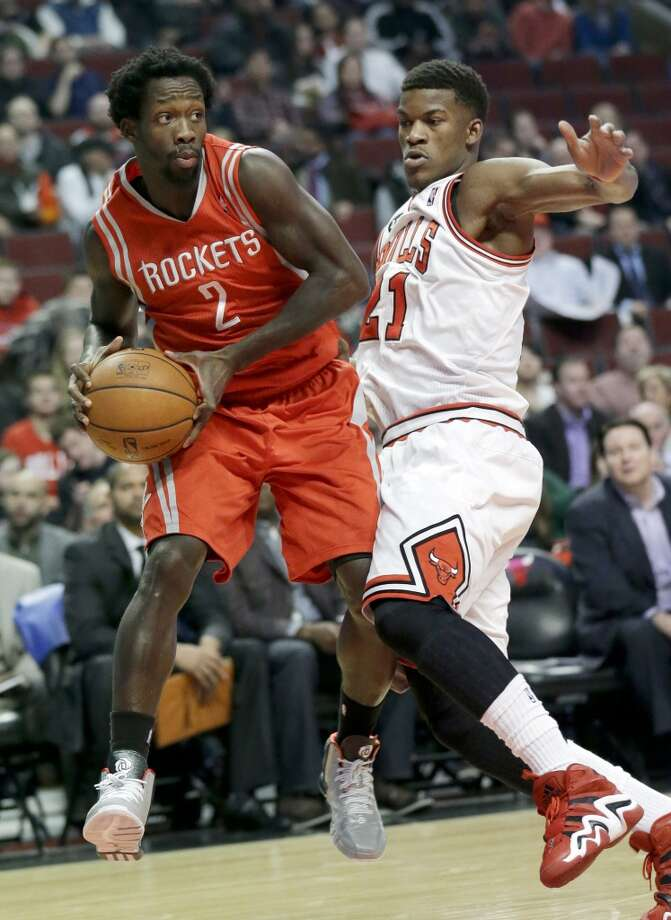 Rockets guard Patrick Beverley, left, looks to pass as Bulls guard Jimmy Butler defends. Photo: Nam Y. Huh, Associated Press