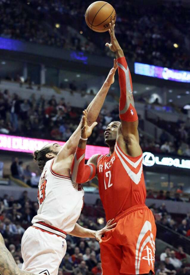 Rockets forward Dwight Howard, right, shoots over Bulls center Joakim Noah. Photo: Nam Y. Huh, Associated Press