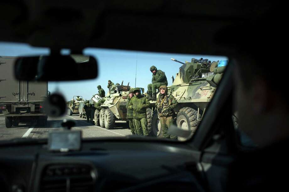 Soldiers presumed to be Russian troops were part of a military buildup near the northern Crimean city of Krasnoperekopsk on Thursday. Photo: URIEL SINAI, STR / NYTNS