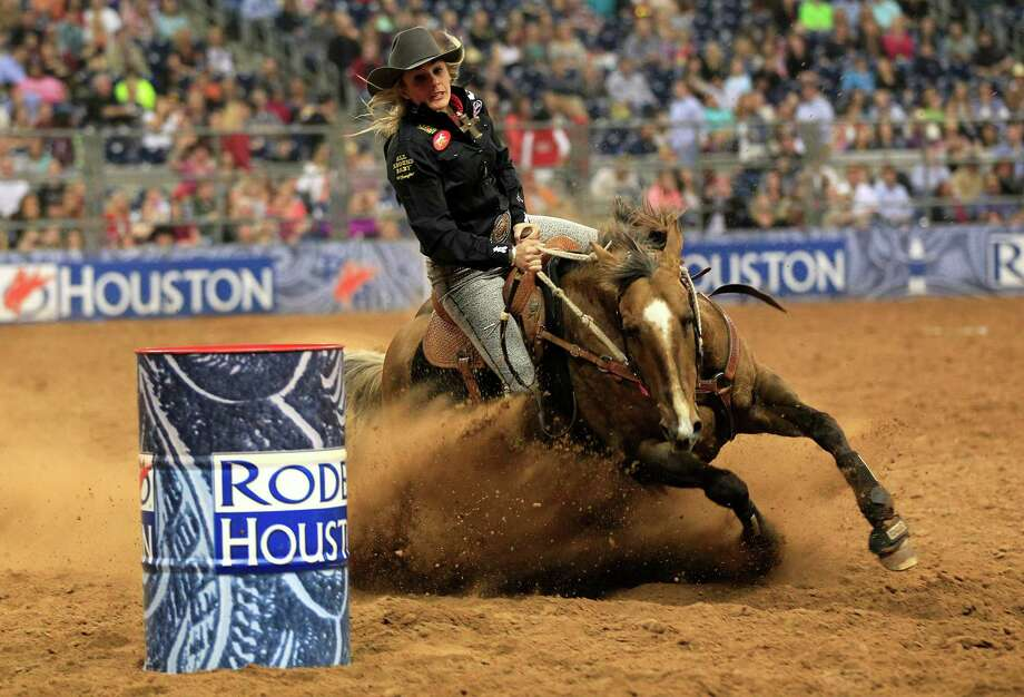 Shada Brazile competes in the Barrel Racing event in the final round of the BP Super Series lll Rodeo Houston at Reliant Stadium Wednesday, March 12, 2014, in Houston. Photo: Johnny Hanson, Houston Chronicle / © 2014  Houston Chronicle