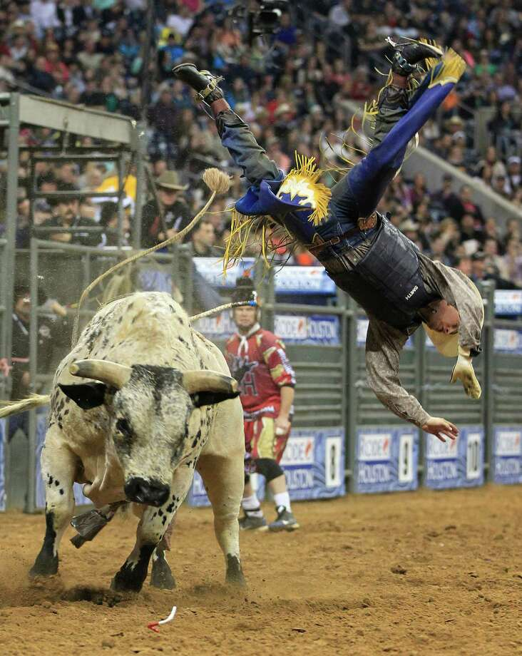 Tyler Smith is bucked off the bull named Black Haul during the final round of the BP Super Series lll Rodeo Houston at Reliant Stadium Wednesday, March 12, 2014, in Houston. Photo: Johnny Hanson, Houston Chronicle / © 2014  Houston Chronicle