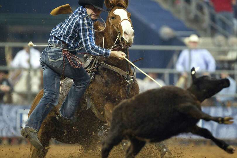 Cliff Cooper ropes a steer in the Tie-Down Roping event  in the final round of the BP Super Series l