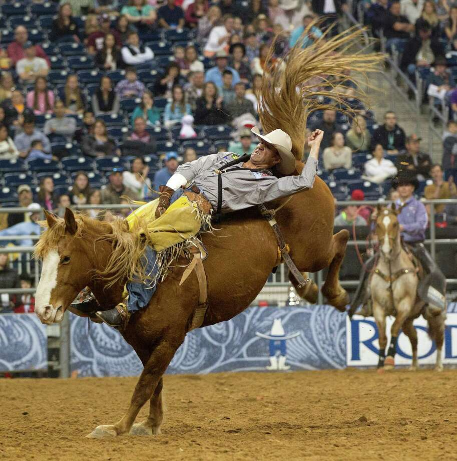 Bobby Mote hangs on to win the Bareback Riding event  during the final round of the BP Super Series lll Rodeo Houston at Reliant Stadium Wednesday, March 12, 2014, in Houston. Photo: Johnny Hanson, Houston Chronicle / © 2014  Houston Chronicle