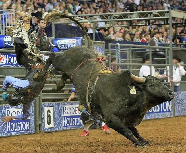 Cody Teel is bucked off a bull during the first round of the BP Super Series lV where he leads the B