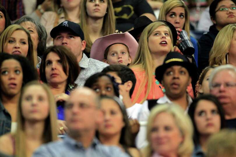 A young rodeo fan watches the first round of the BP Super Series lV at Rodeo Houston in Reliant Stad