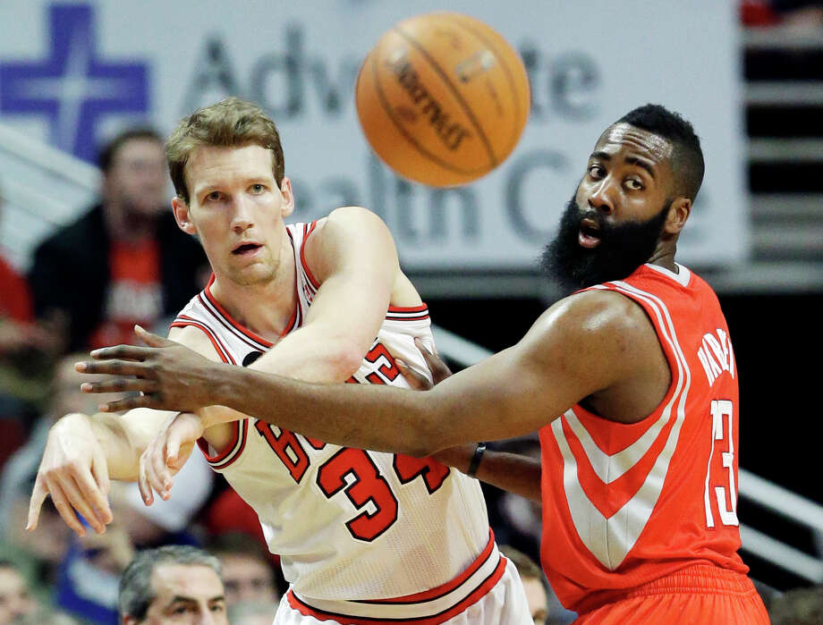 Chicago Bulls guard Mike Dunleavy, left, and Houston Rockets guard James Harden watch the ball after Dunleavy passed it during the first half of an NBA basketball game in Chicago on Thursday, March 13, 2014. (AP Photo/Nam Y. Huh) ORG XMIT: CXA110 Photo: Nam Y. Huh / AP