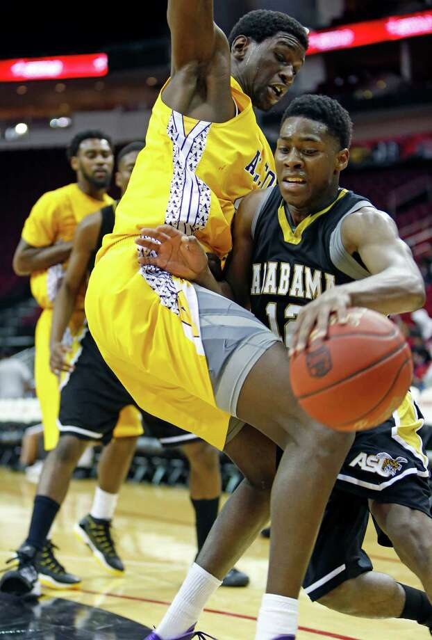 "Toyota Center--action from SWAC basketball tournament. 2nd half action, Alabama State ""Hornets"" (in black) against Alcorn State ""Braves"" (in yellow). Alabama State won 64-51.