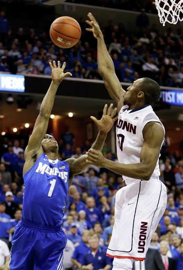 Connecticut guard Lasan  Kromah, right, blocks a shot by Memphis guard Joe Jackson (1) during the  first half of an NCAA college basketball game in the quarterfinals of  the American Athletic Conference tournament Thursday, March 13, 2014, in  Memphis, Tenn. (AP Photo/Mark Humphrey)