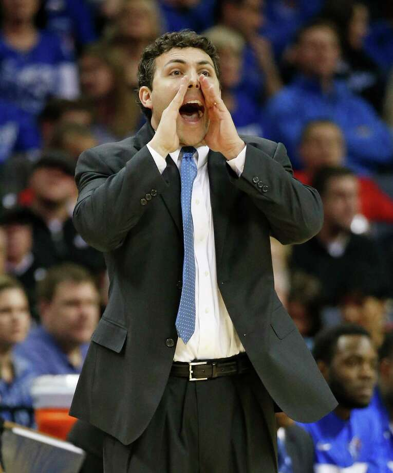Memphis coach Josh Pastner yells to his players during the first half of an NCAA college basketball game against Connecticut in the quarterfinals of the American Athletic Conference tournament Thursday, March 13, 2014, in Memphis, Tenn. (AP Photo/Mark Humphrey) Photo: Mark Humphrey, Associated Press / Associated Press