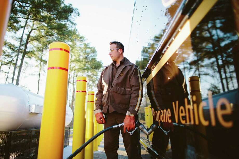 UPS driver Robert Mendez fuels up with propane in Gainesville, Ga. The company plans 50 refueling stations. / ©2014 Geoff Johnson