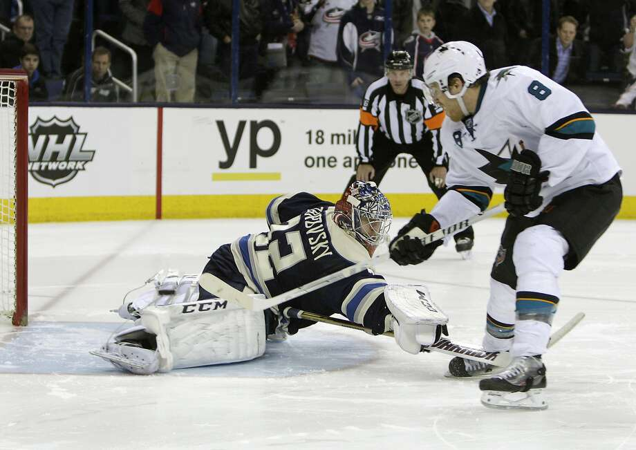 Joe Pavelski flips a backhand shot past Sergei Bobrovsky for the winner in the shootout. Photo: Jay LaPrete, Associated Press