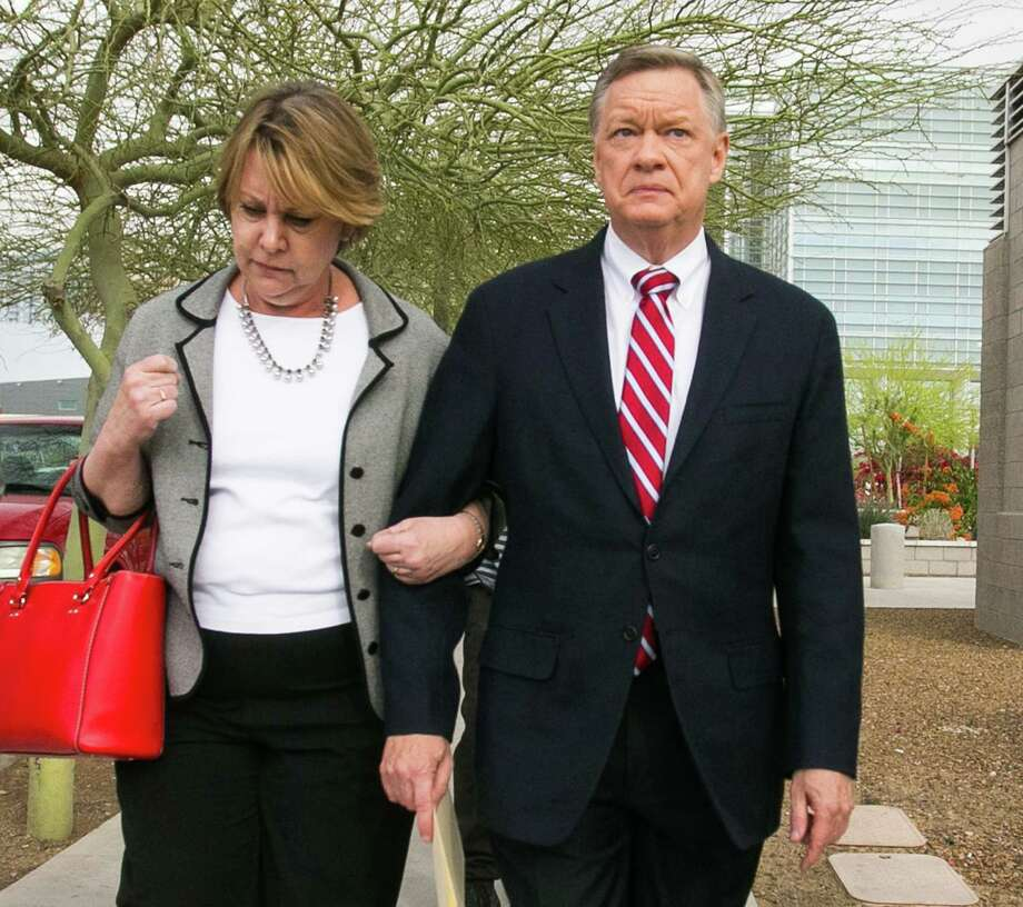 Former Fiesta Bowl executive director John Junker, right, leaves the courthouse Thursday after being sentenced to eight months in federal prison. Photo: Michael Schennum, MBO / The Arizona Republic