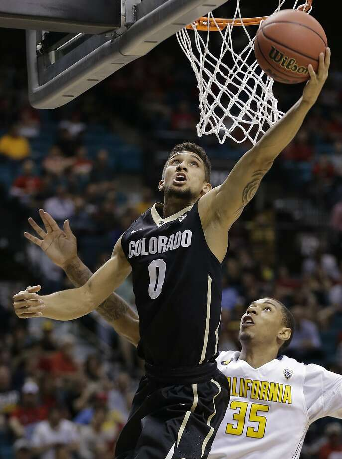 Colorado's Askia Booker gets by Richard Solomon in the second half. Booker had 17 points. Photo: Julie Jacobson, Associated Press