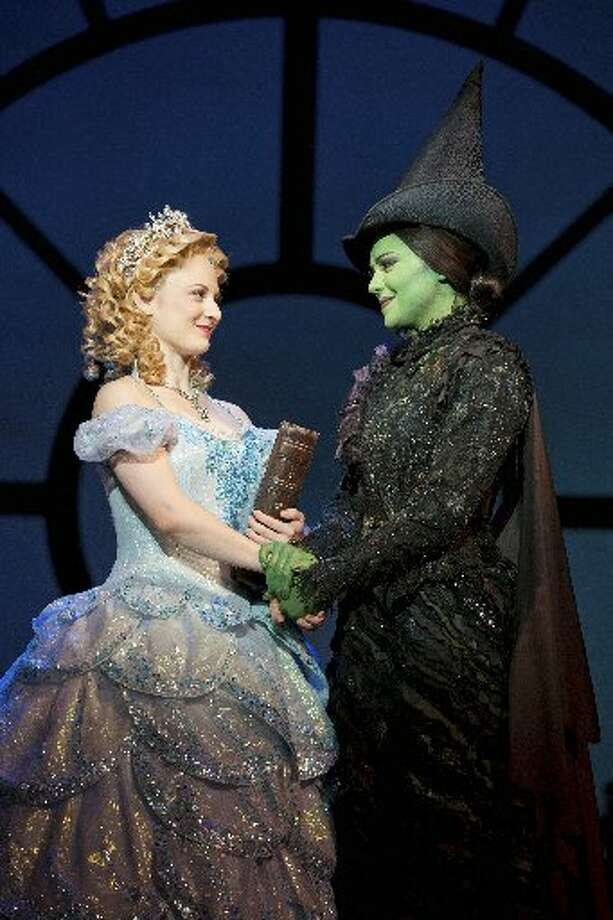 "Hayley Podschun and Jennifer DiNoia play Glinda and Elphaba in the national tour of ""Wicked."" Photo courtesy of Joan Marcus."