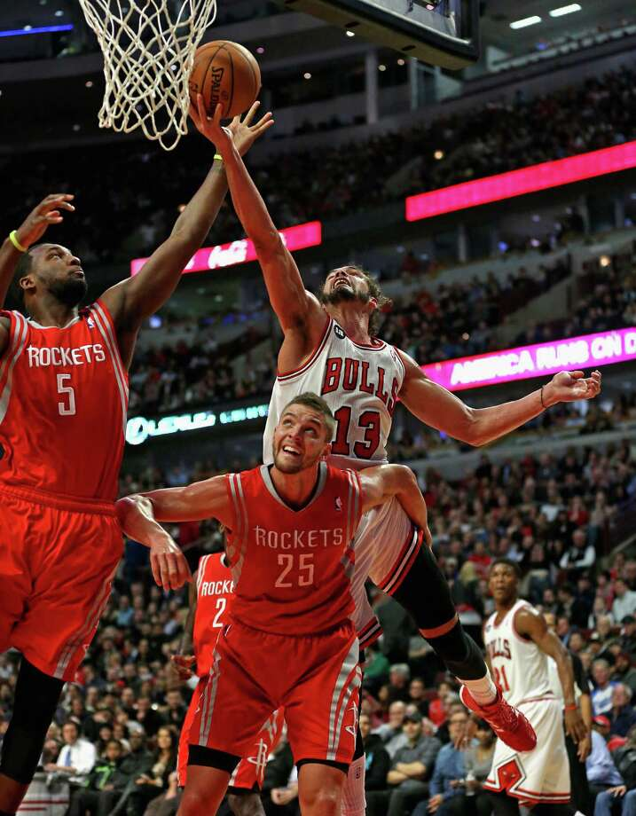 The Bulls' Joakim Noah, right, flirted with a triple-double Thursday night, scorching Jordan Hamilton, left, Chandler Parsons and the Rockets with 13 points, 10 rebounds and nine assists. Photo: Jonathan Daniel, Staff / 2014 Getty Images