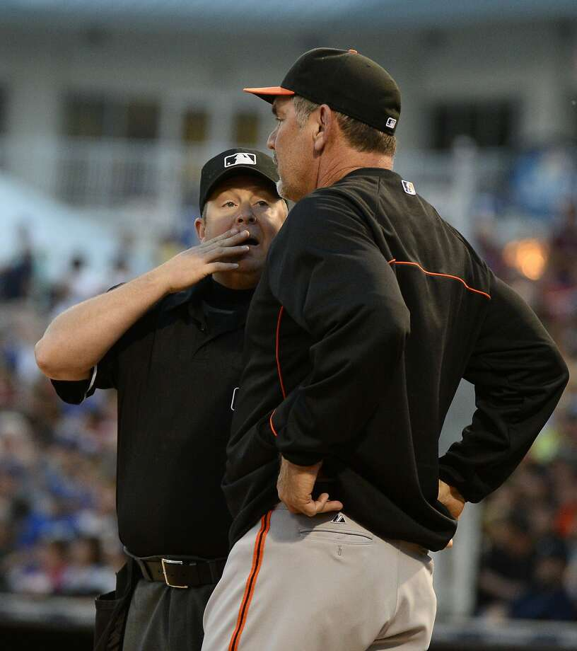 Manager Bruce Bochy asks home-plate umpire Todd Tichenor to review the play at first on a double play. Bochy was right. Photo: Christopher Hanewinckel, Reuters