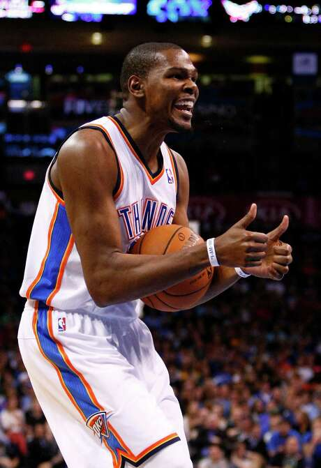 The Thunder's Kevin Durant doesn't like a referee's call, but he had to like a rout of the Lakers. Photo: Alonzo Adams, FRE / FR159426 AP