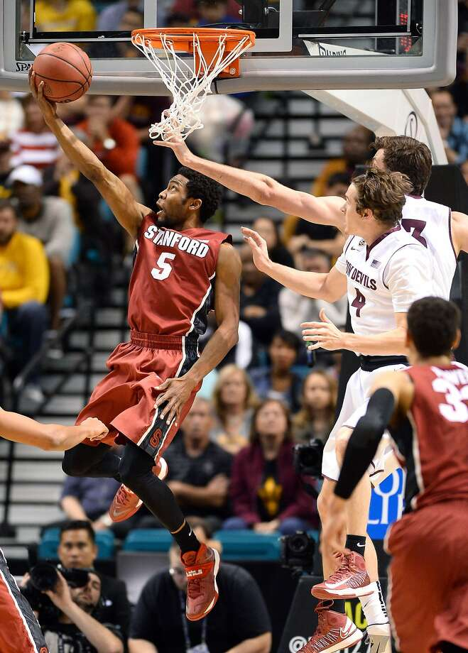 Stanford's Chasson Randle scores on a reverse layup against Arizona State's Bo Barnes (front right) and Jordan Bachynski at the Pac-12 tournament. Randle had a game-high 21 points. Photo: Ethan Miller, Getty Images
