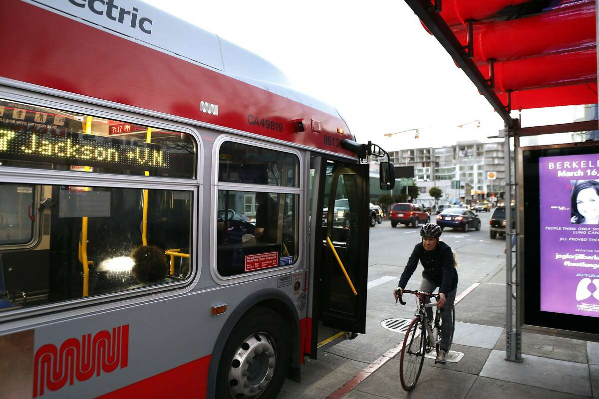 A 27 Bryant Muni bus stops in a bus stop at the intersection of 5th Street and Harrison Street as a bicyclist peddles by in San Francisco, Calif., on Thursday, March 13, 2104. Proposed changes to several Muni lines have sparked outrage from riders long-accustomed to their buses and routes. Riders of the 27 Bryant were so vocal about the proposed changes that the intended removal of service from Bryant Street as reconsidered by the transit agency.