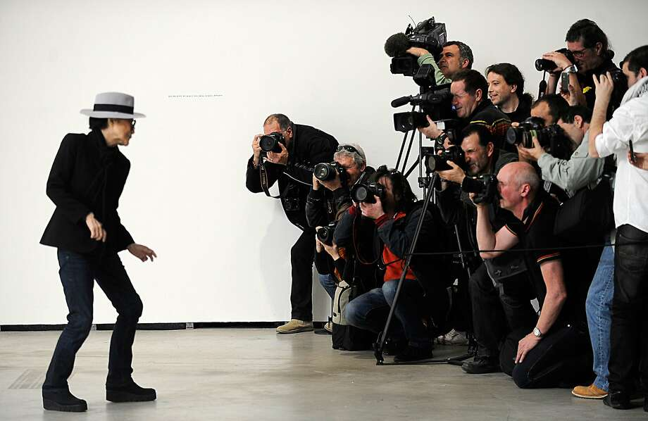 "Yoko Ono poses for photographers during the presentation of her exhibition ""Yoko Ono. 