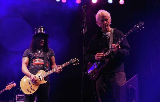 AUSTIN, TX - MARCH 13:  Recording artists Slash and Robby Krieger perfom onstage at the U.S. Postal Service unveiling of the Jimi Hendrix ForeverAE Stamp during South by Southwest (SXSW) on March 13, 2014 in Austin, Texas. Photo: Jonathan Leibson, Getty Images For US Postal Servi / 2014 Getty Images