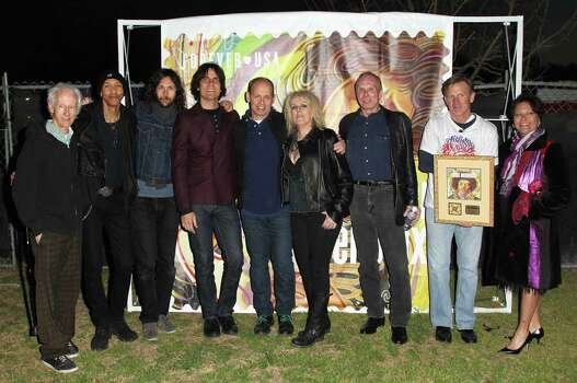 AUSTIN, TX - MARCH 13: (L-R) Robby Kregier, Doug Pinnick, Rusty Anderson, Wayne Kramer, Lucinda Williams, Phil Alvin and Joe Corbett attend the U.S. Postal Service unveiling of the Jimi Hendrix ForeverAE Stamp during South by Southwest (SXSW) on March 13, 2014 in Austin, Texas. Photo: Jonathan Leibson, Getty Images For US Postal Servi / 2014 Getty Images