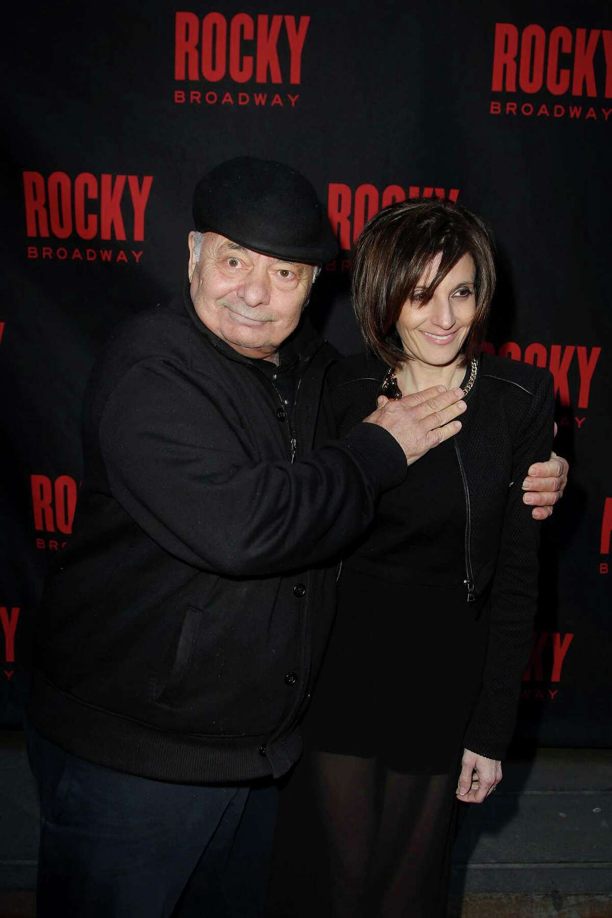 This image released by Starpix shows actor Burt Young, left, and Lisa Scuteri arriving at opening night of the Broadway musical