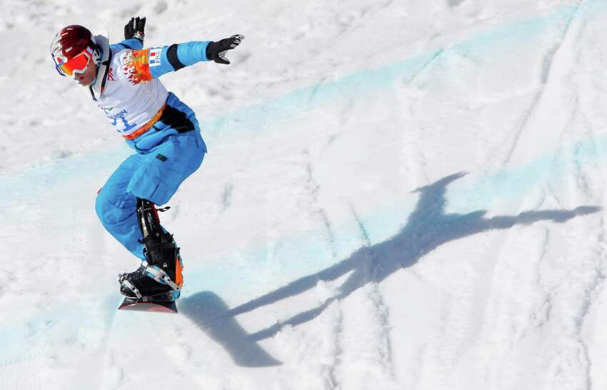 Patrice Barattero of France competes during men's para snowboard cross, standing event at the 2014 Winter Paralympic, Friday, March 14, 2014, in Krasnaya Polyana, Russia.