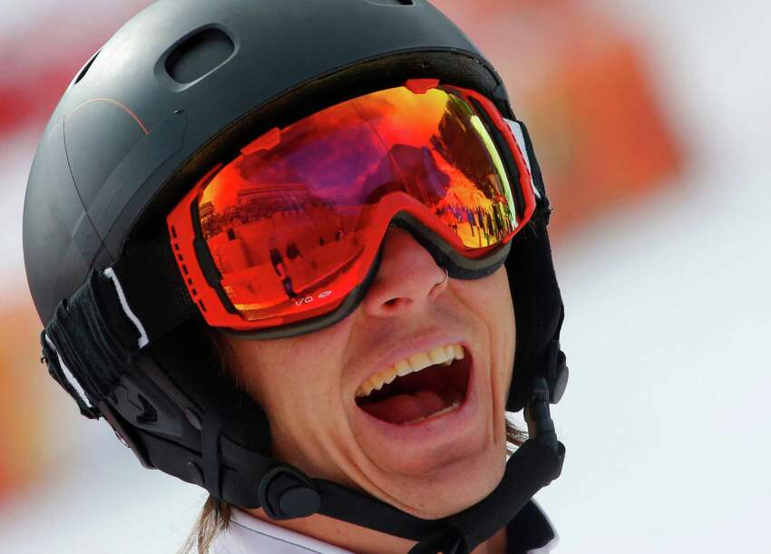 Evan Strong of United States celebrates his victory in the men's para snowboard cross, standing event at the 2014 Winter Paralympic, Friday, March 14, 2014, in Krasnaya Polyana, Russia.