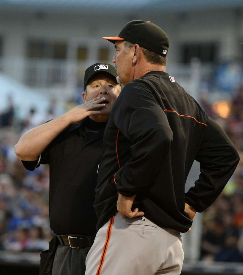 San Francisco Giants manager Bruce Bochy (right) asks home plate umpire Todd Tichenor to review a play during the second inning against the Texas Rangers at Surprise Stadium. Photo: Christopher Hanewinckel, Reuters