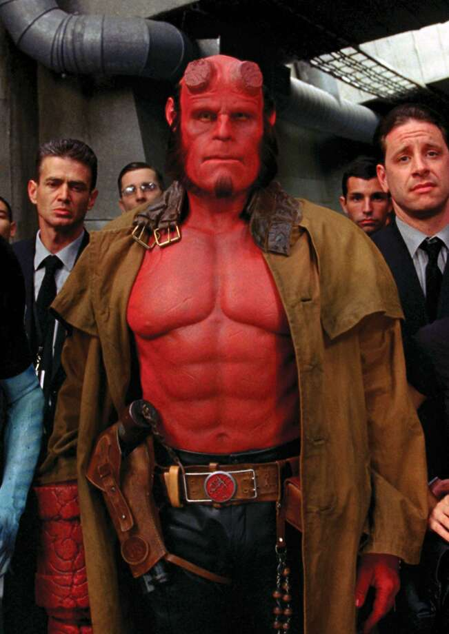 "Hellboy (that's Ron Perlman in ""Hellboy II: The Golden Army"") might be a horned red devil, but part of his attraction is that he comes off as a regular person, says creator Mike Mignola. Photo: Egon Endrenyi, Associated Press"