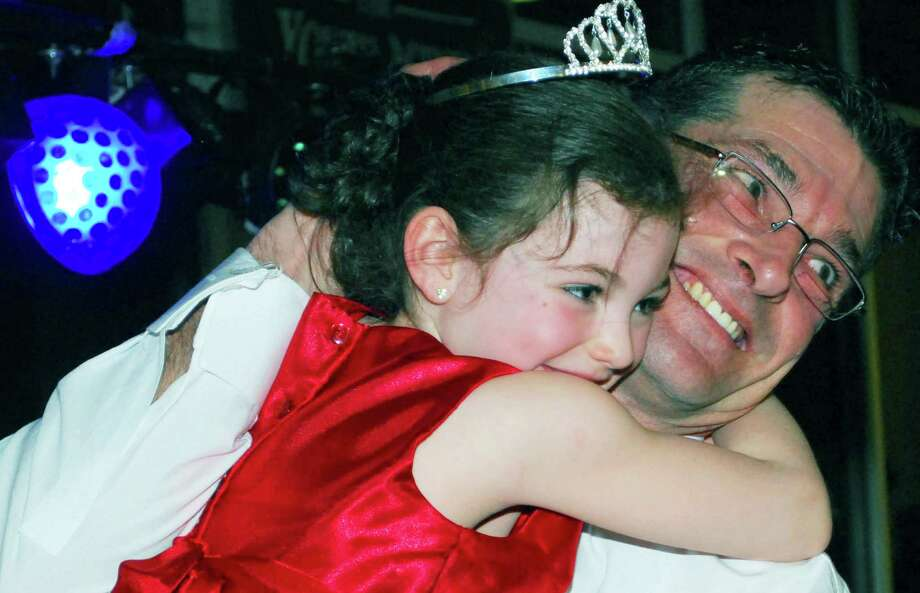The prince and princess of the Girl Scout Sweetheart Dance - Gordie Fairchild  and his granddaughter, Alacey Fairchild, 5 -  enjoy their moment as royalty after theire coronation during the Sweetheart Dance, hosted by New Milford Girl Scout troops 40237 and 40238 Feb. 21 at New Milford High School. Photo: Deborah Rose / The News-Times