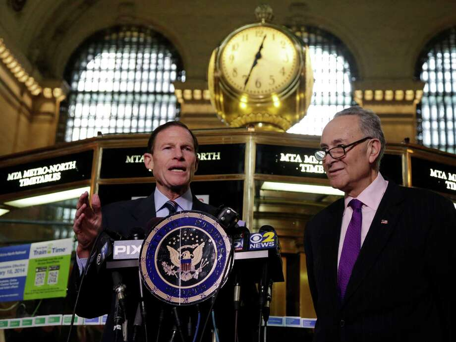 """U.S. Sen. Richard Blumenthal, D-CT, left, and U.S. Sen. Charles Schumer, D-NY, comment during a news conference on a report by the Federal Railroad Administration about the Metro-North Railroad, at the information booth in New York's Grand Central Terminal, Friday, March 14, 2014. Metro-North commuter railroad has allowed an overemphasis on train times to """"routinely"""" overshadow its safety operations, according to an FRA review that was released Friday. Photo: Richard Drew, AP Photo/Richard Drew / Associated Press AP Photo/Richard Drew"""