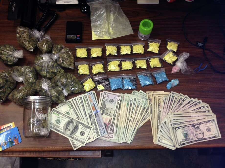 Richmond police say they discovered this stash of cash and drugs in Rodrigo Ivan Garcia's backpack after a traffic stop. Photo: Richmond Police Department