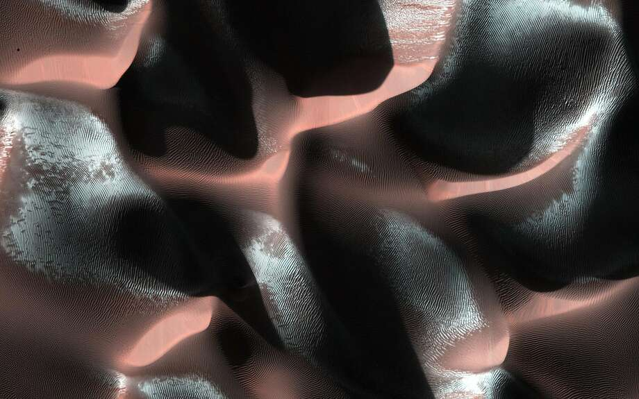 Mars' frosty dunes: A NASA image shows a sand dune field in a Southern Highlands crater on Mars. The 