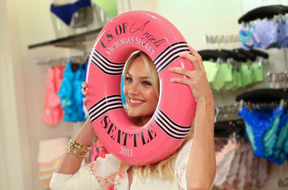 Care for a Candy life saver? Supermodel Candice Swanepoel has a hole lot of fun during a photo shoot at a Victoria's Secret store in the Bellevue (Wash.) Square Mall. Photo: Joshua Trujillo, Seattlepi.com