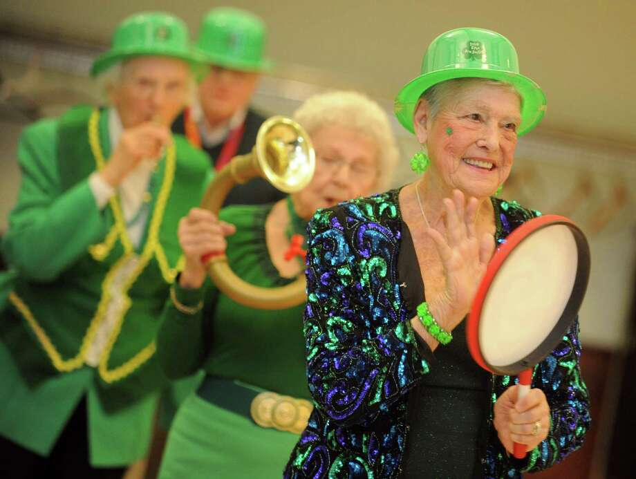 Ann Singleton marches with the band as the Baldwin Players present their St. Patrick's Revue Friday, Mar. 14, 2014 at the Baldwin Center in Stratford, Conn. Photo: Autumn Driscoll / Connecticut Post