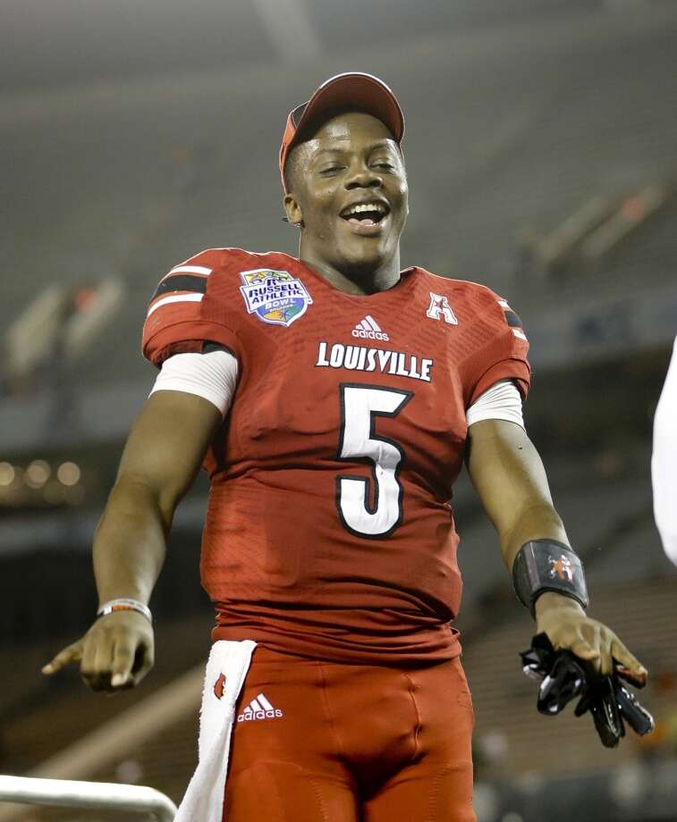 If the Texans select a quarterback with the No. 1 overall pick of the 2014 NFL draft, it'll be either Louisville's Teddy Bridgewater, Central Florida's Blake Bortles or Texas A&M's Johnny Manziel. University of Houston defensive coordinator David Gibbs and Rice defensive coordinator Chris Thurmond faced the trio last season. The coaches used game tape to break down the performances for the Houston Chronicle. Photo: John Raoux, Associated Press