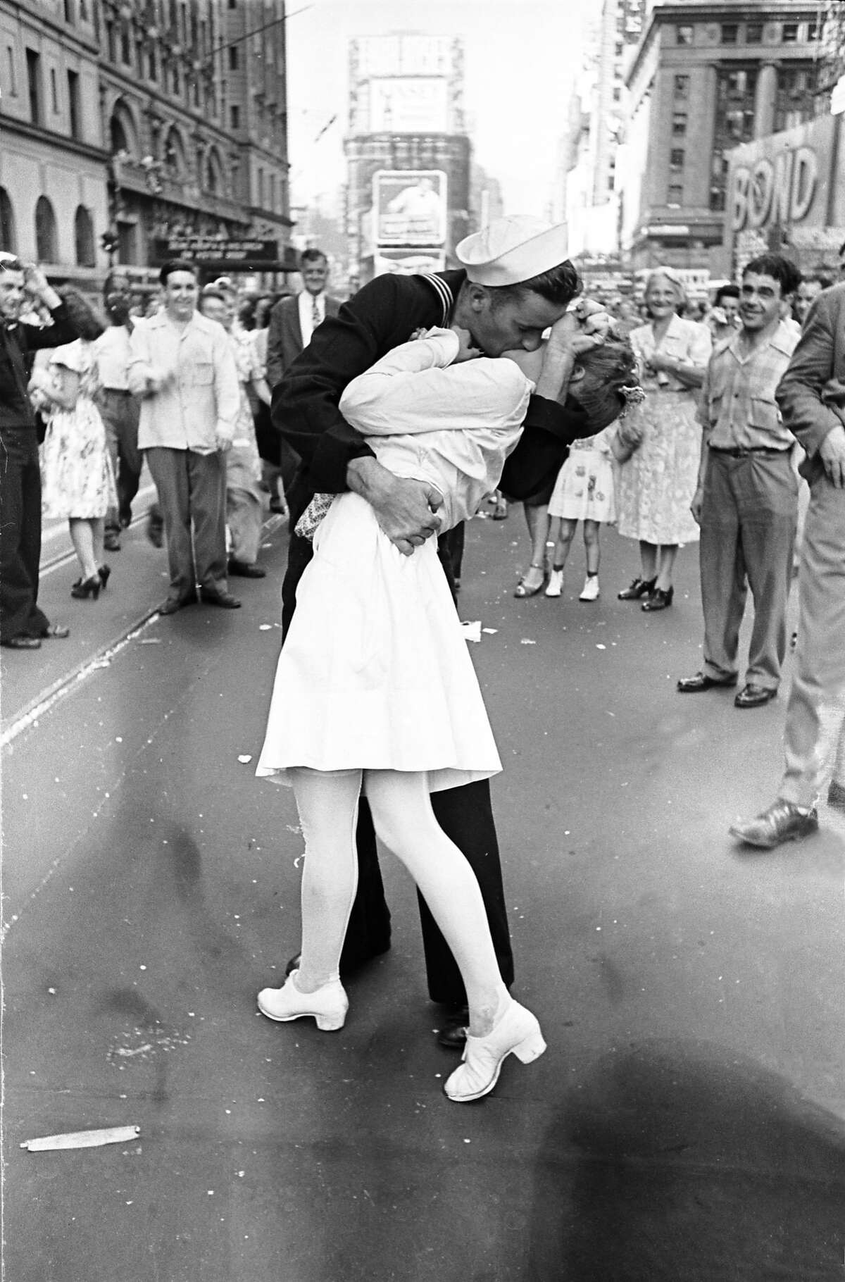 As pedestrians watch, an American sailor passionately kisses a white-uniformed nurse in Times Square to celebrate the long awaited-victory over Japan. August 14, 1945. This is an outtake that is not the iconic image for which Eisenstaedt is widely know. (Photo by Alfred Eisenstaedt/Time & Life Pictures/Getty Images)