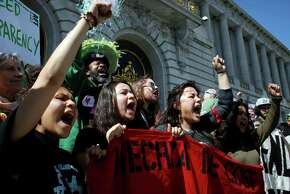 City College of San Francisco students protest accreditation reforms in 2014, including the temporary replacement of the elected Board of Trustees with a state-appointed trustee, and the requirement that students pay college fees upon registration.