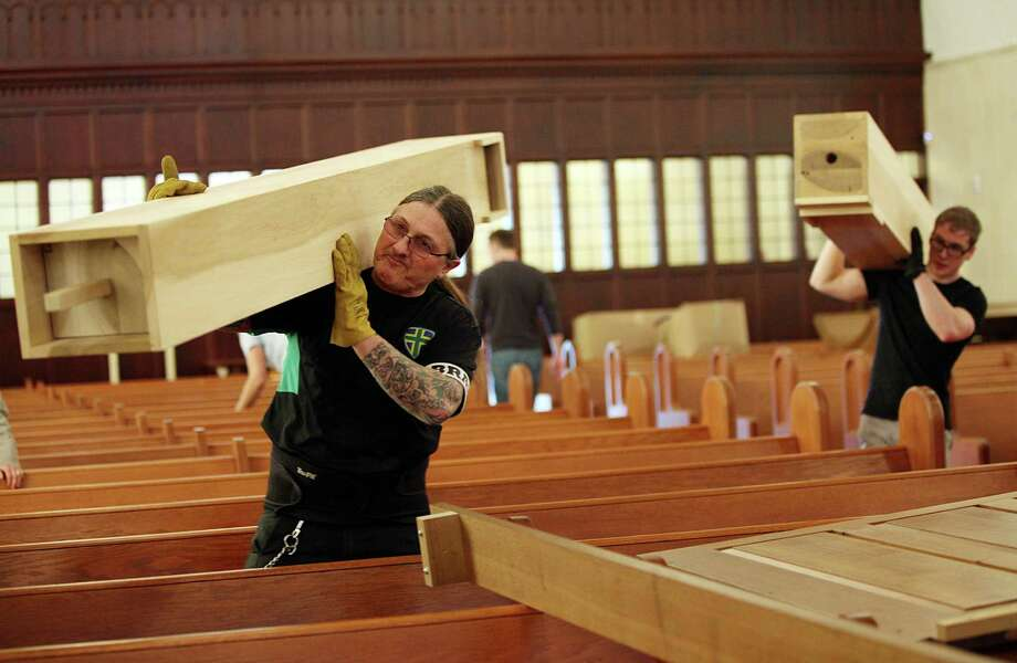 Markus Morscher carries a pipe over his should of the new pipe organ to replace the one that was damaged in a fire at First Evangelical Lutheran Church in downtown on March 10, 2014, in Houston. The assembly of the organ will take a week, then the tuning will take 3 weeks. It's scheduled to be dedicated Easter Sunday, April 20th. ( Mayra Beltran / Houston Chronicle ) Photo: Mayra Beltran, Staff / © 2014 Houston Chronicle