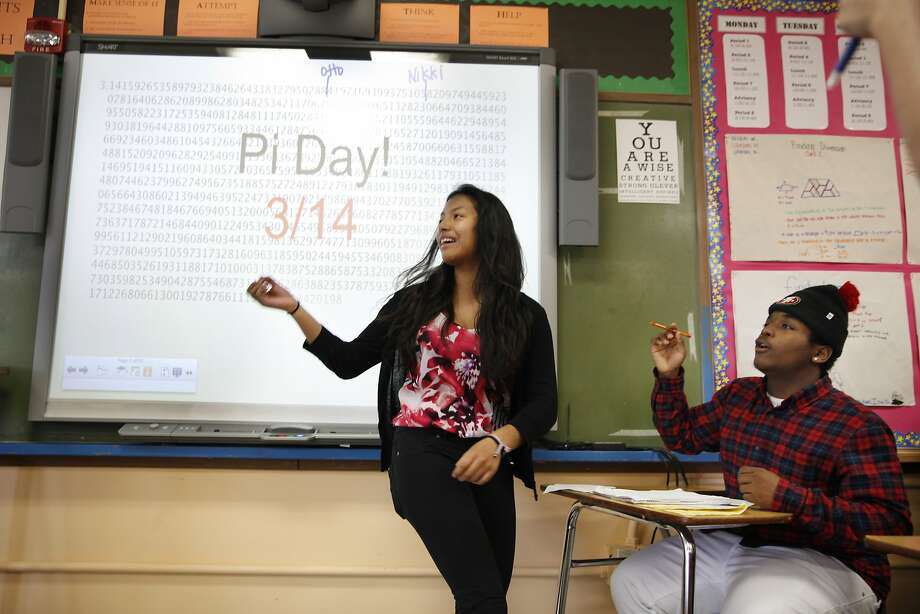 Damaris Orellana (left, with classmate Jahmal Bolãnos) says she wants to write out pi instead of recite it. Photo: Lea Suzuki, The Chronicle
