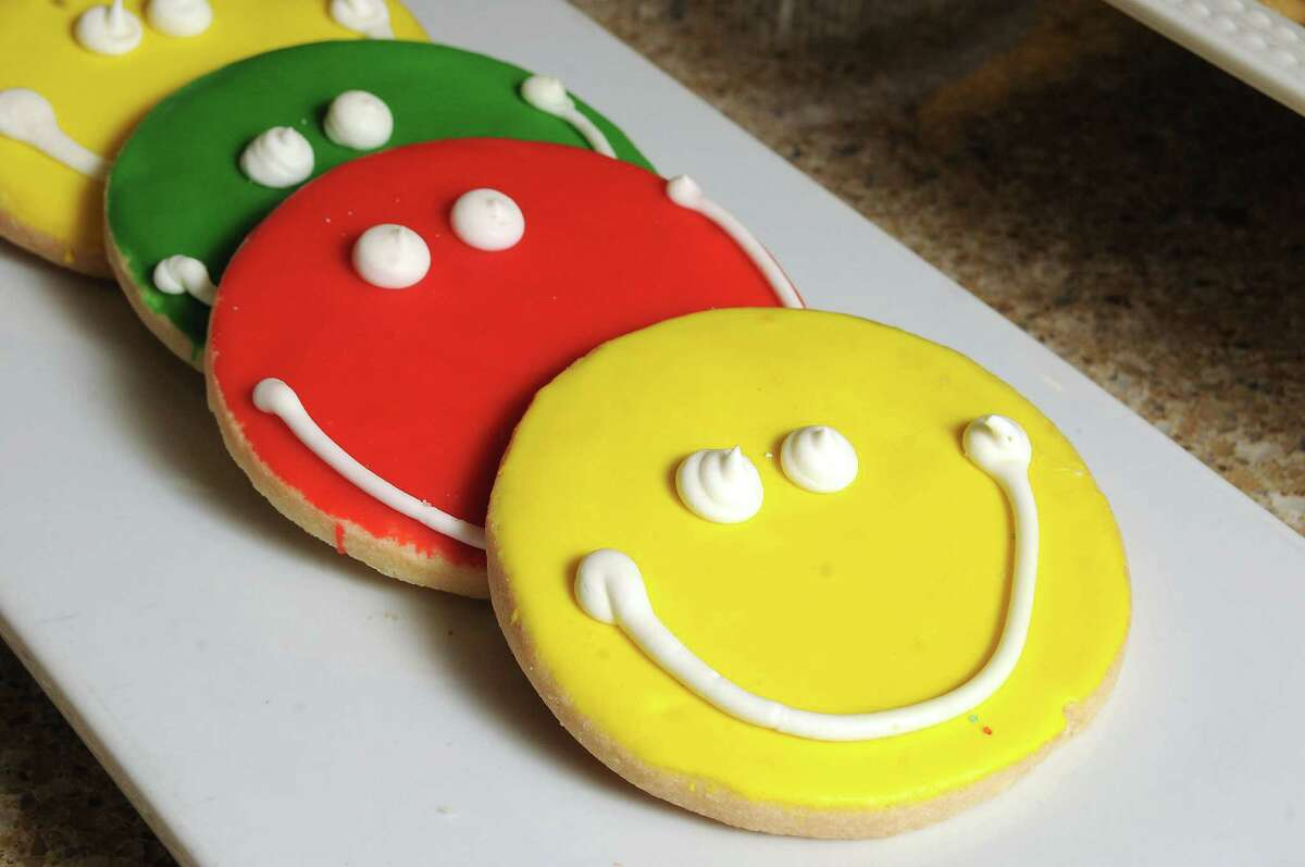 Colorful smiley faced cookies at Michael's Cookie Jar in the tunnel beneath the Pennzoil building Friday March 7, 2014.(Dave Rossman photo)