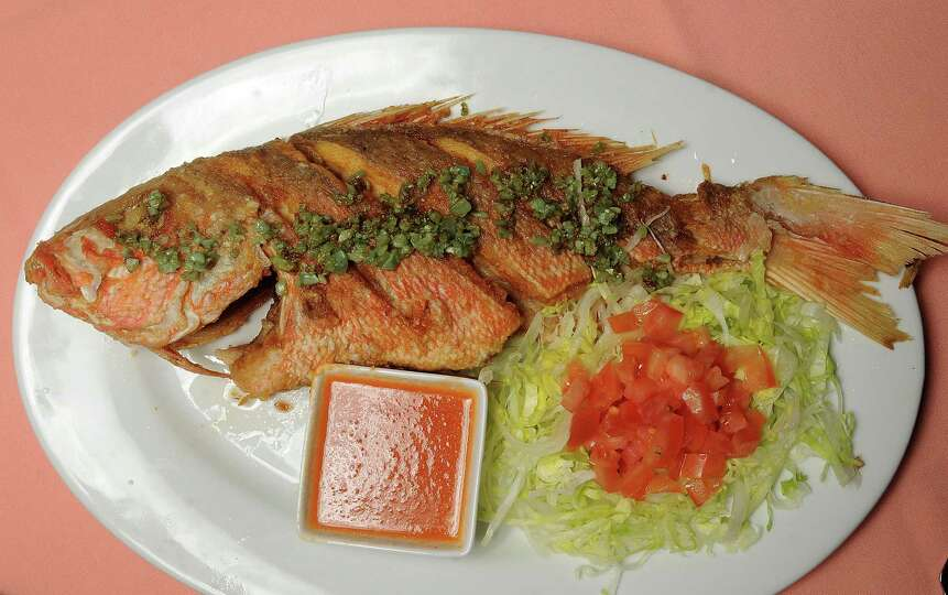 The whole red snapper, pan sauteed in garlic-infused olive oil is ...