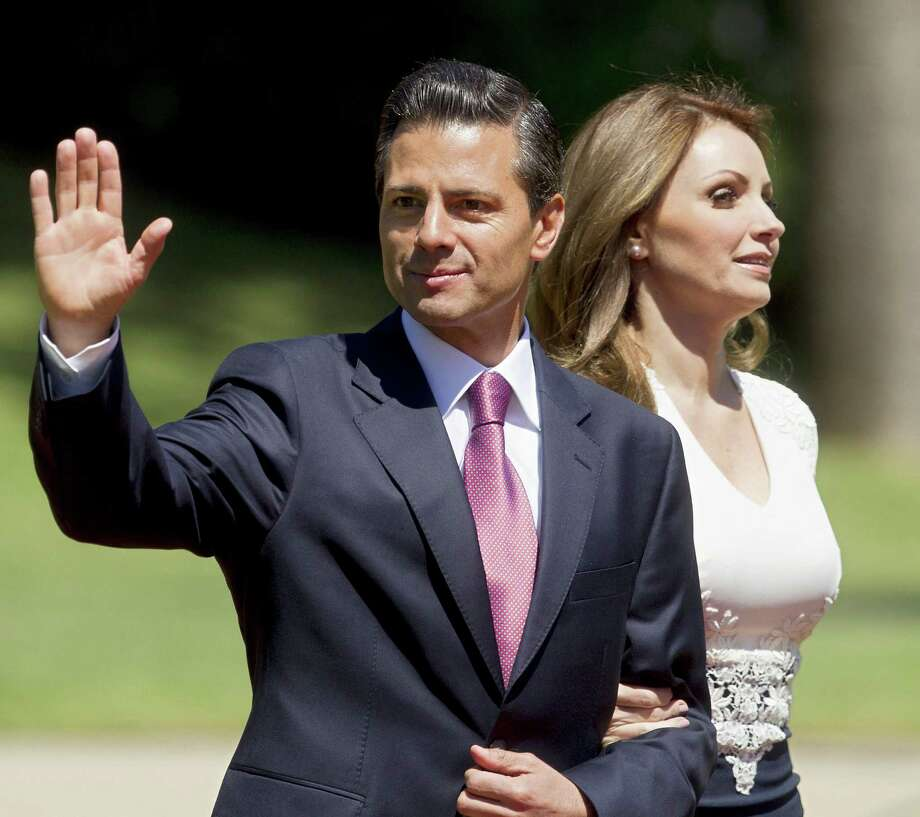 A reader says Mexican President Enrique Peña Nieto, shown here during a recent trip to South America, should worry about improving economic conditions in his own country before condemning U.S. immigration policy. Photo: Claudio Reyes / AFP / Getty Images / AFP