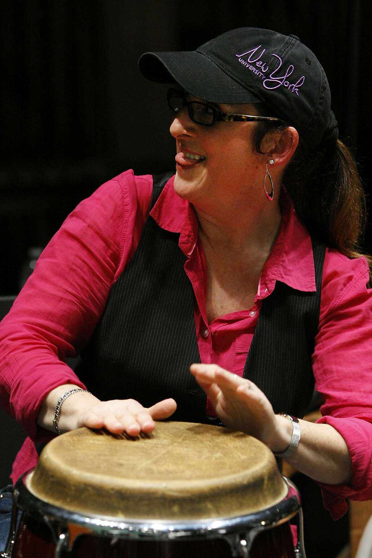 Rebeca Mauleon plays a conga drum during a jam session at the end of the JazzGirls Day performance at the Berkeley High Community Theater in Berkeley, CA, Saturday, March 8, 2014.
