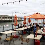 Red's Java House: This clapboard shack is a rite-of-passage experience that seemingly every native relishes. You can sit inside, on the patio or out front on one of the cement pylon benches and chow down on reasonably priced food. The hamburger on a sourdough roll and a beer is $9.25. Pier 30; (415) 777-5626. www.redsjavahouse.com. Breakfast and lunch daily.