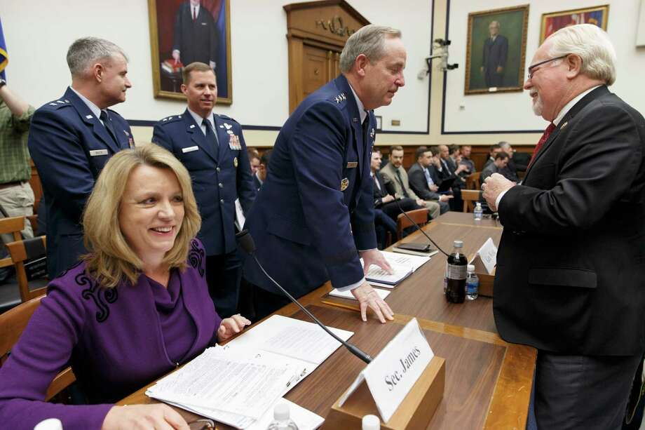 """Air Force Chief of Staff Gen. Mark Welsh?, center, speaks with Rep. Ron Barber, D-Ariz., right, as he and Air Force Secretary Deborah Lee James, left, arrive on Capitol Hill in Washington, Friday, March 14, 2014, to testify before the House Armed Services Committee on the fiscal 2015 budget request. The Associated Press has uncovered a series of security lapses and other troubles in the nation's nuclear forces. The issue came to a head in January when Defense Secretary Chuck Hagel summoned top military leaders and ordered a review of the problems. Airmen responsible for missile operations at Minot Air Force Base would have failed their portion of a major inspection in March 2013 but managed a """"marginal"""" rating because their poor marks were blended with the better performance of support staff — like cooks and facilities managers.  (AP Photo/J. Scott Applewhite) Photo: J. Scott Applewhite, STF / AP"""