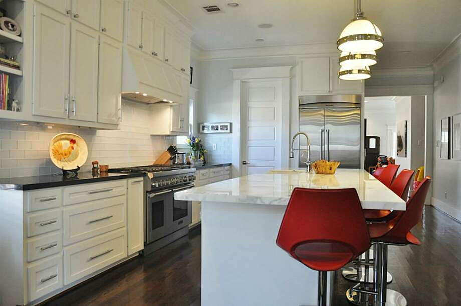 1245 Tulane: This 1930 home has 4 bedrooms, 3.5 bathrooms, and 3,216 square feet. Listed for $969,000. Open house: 3/16/2014, 2 p.m. to 4 p.m. Photo: Houston Association Of Realtors
