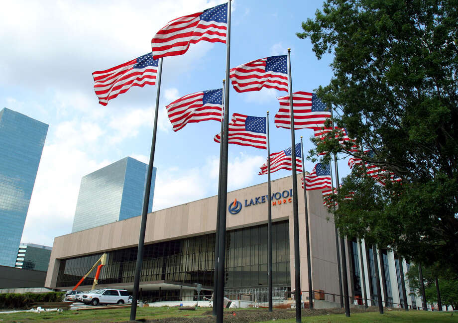 FILE - Flags fly in front of Lakewood Church in this June 28, 2005 file photo. A service at 11 a.m. April 27 will honor military caregivers. (AP Photo/Pat Sullivan, File) Photo: PAT SULLIVAN, STF / AP